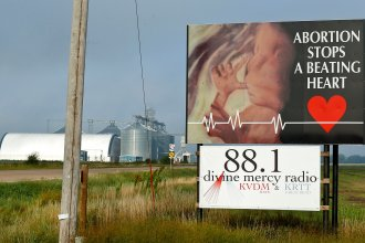 A roadside sign in rual Kansas opposing abortion. (Photo by Chris Neal)