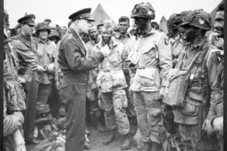 """General Dwight """"Ike"""" Eisenhower speaks to American Airborne troops prior to the Normandy invasion of World War Two."""