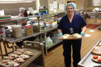 Theresa Ater prepares the evening meal in the cafeteria of Russell Regional Hospital.