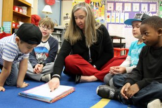First grade teacher Shauna Hammett focuses on phonics with her students, deploying a method that's backed by research — something state rules will soon demand. (photo credit: Celia Llopis Jepsen / Kansas News Service)