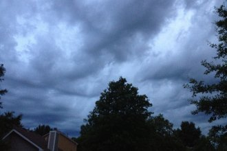 Dark clouds gather above Lawrence in this file photo from J. Schafer.