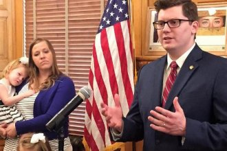 State Sen. Jake LaTurner was announced Tuesday as Gov. Sam Brownback's pick to succeed Ron Estes as state treasurer. LaTurner, of Pittsburg, has served in the Kansas Senate since 2013. At left is his wife, Suzanne. (photo credit: Jim McLean/Kansas News Service)