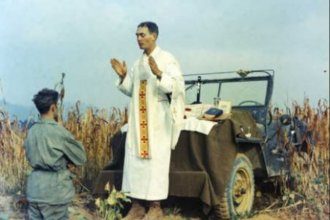 A photo showing Kapaun holding mass. (Photo from the U.S. Army)