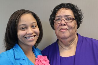 "Kelsie Gonzalez (left) interviews her grandmother, Katherine Sawyer, about growing up in segregated Topeka.  Sawyer was just 10 years old when she testified in a Topeka courtroom, during an early legal challenge to school segregation.  Her testimony and the testimony of others set the stage for what would later become the consolidated case of ""Brown v. Topeka Board of Education."""