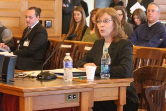Kathryn Gardner speaking during the hearing. (Photo by Stephen Koranda)
