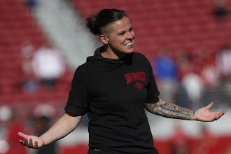San Francisco 49ers assistant coach Katie Sowers grew up in Hesston, Kansas. She also has the Kansas City skyline tattooed on her forearm. (AP Photo by Jose Lepe)