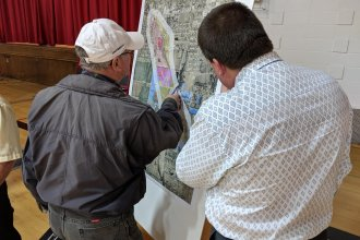 A KDHE employee explains a map of a plume of toxic dry cleaning chemicals in December 2017.  (Photo by Brian Grimmett, Kansas News Service)