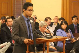 Kelvin Lopez urges lawmakers not to repeal the in-state tuition law for certain undocumented immigrants. (Photo by Stephen Koranda)
