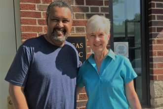 Kevin Willmott and Kaye McIntyre outside the KPR studios