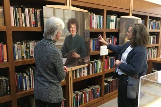 Kaye McIntyre and Audrey Coleman look at portrait of Elizabeth Dole