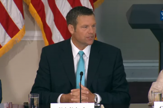 Secretary of State Kris Kobach speaking at the meeting Wednesday.