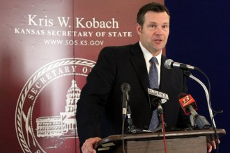 Secretary Kobach speaking to repoters last year. (Photo by Stephen Koranda)