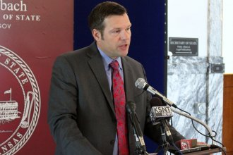 File photo of Secretary of State Kris Kobach speaking to reporters. (Photo by Stephen Koranda)