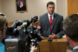 Secretary Kobach speaking to reporters. (File photo by Stephen Koranda)