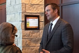 Kansas Secretary of State Kris Kobach talks to attendees at the Kansas Republican Party annual convention, which was held Saturday in Manhattan.  (Photo by Jim Mclean)