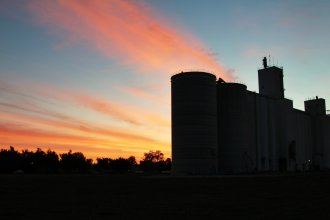 """The sun rises over a grain elevator, near the town of Here, Kan. (Photo by J. Schafer, who says, """"There's not really a Here, Kan."""")"""