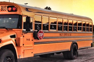 A typical Kansas school bus; this one carried the Valley Center volleyball team to the state tournament in Topeka in 2014.  It's simply used here for illustrative purposes; to represent education. (Photo by J. Schafer)