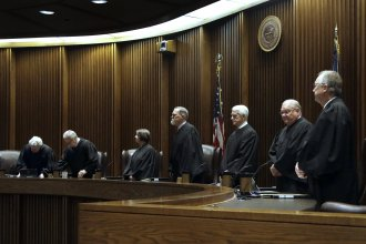 Kansas Supreme Court justices on the day this spring they heard the latest arguments about school spending. (Associated Press pool photo by Orlin Wagner)