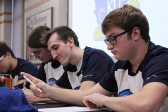 Six KU students sign contracts to join the university's varsity esports team. (Photo by Stephan Bisaha, Kansas News Service)