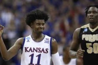 KU's Josh Jackson celebrates lead as Purdue's Caleb Swanigan tries to catch up.