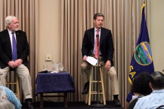 Governor Sam Brownback and state Senator Steve Fitzgerald at the meeting. (Photo by Stephen Koranda)