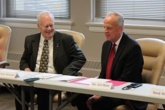 Senator Jerry Moran speaking with Board of Education Chairman Jim Porter. (Photo by Stephen Koranda)