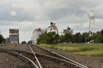 Photo of train tracks and grain elevator, by Chris Neal/Kansas News Service