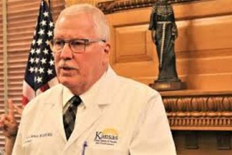 Kansas Department of Health and Environment Secretary Lee Norman discussing state preparedness for the coronavirus at a statehouse news conference. (Photo Credit: Jim McLean, Kansas News Service)