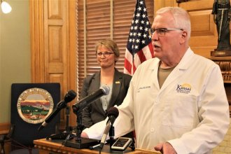 KDHE Secretary Lee Norman at a press conference Saturday, confirming the first known case of COVID-19 in Kansas. (Photo by Jim McLean, Kansas News Service)