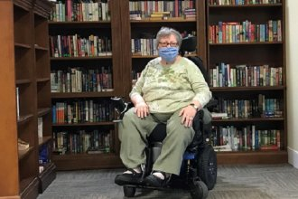 Pat Gray gave up her crutches in 2006 and began using a wheelchair so that her arms would stay strong. (Photo by Anne Kniggendorf, Kansas News Service)
