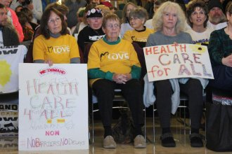 Medicaid expansion advocates attend a rally last month at the Kansas Statehouse. (Photo by Stephen Koranda)