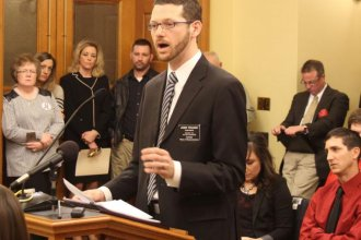 Representative John Wilson speaking last year. (Photo by Andy Marso)