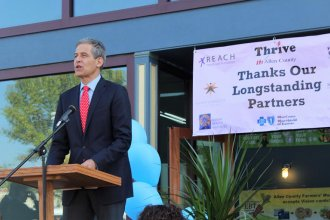 Richard Besser, president and CEO of the Robert Wood Johnson Foundation, speaks Tuesday in Iola during a ceremony honoring the community's health-improvement efforts. Allen County was one of eight in the nation selected for the honor this year.  (Photo by Jim McLean, Kansas News Service)