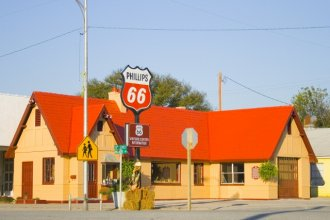 Service station along Route 66 in Baxter Springs, Kansas. Only a dozen miles of the famous highway cuts through the extreme corner of southeast Kansas.