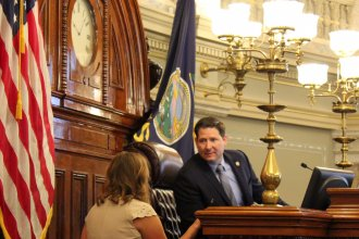 House Speaker Ron Ryckman speaking to a staff member before opening the House session. (Photo by Stephen Koranda)