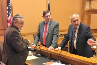 Buddhadeb Dawn, right, executive director of the Midwest Stem Cell Therapy Center, talks with Rep. Les Osterman, far left, and David Prentice, center, of Charlotte Lozier Institute. (Photo: Andy Marso, Kansas News Service)