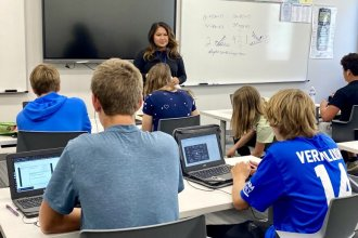Substitute teacher Serle McNeil leads an algebra class at Andover High School. McNeil is one of a team of full-time subs rounded up last year to fill in a suddenly chronic shortage. (Photo by Suzanne Perez, KMUW)
