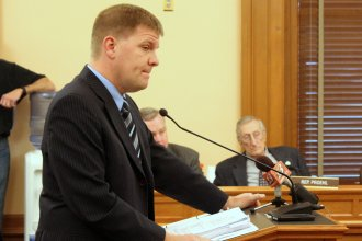 Budget Director Shawn Sullivan listens to a question from a lawmaker Wednesday. (Photo by Stephen Koranda)