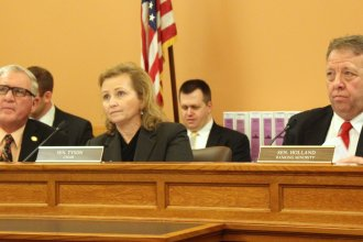 Senators listen during a hearing on the tax plan. From left to right are Republican Dan Kershen, Republican Chairwoman Caryn Tyson and Democrat Tom Holland. (Photo by Stephen Koranda)