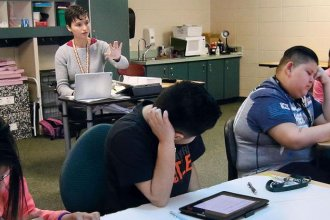 Teacher Sarah Drubinskiy leads her students in a lesson at a school in Garden City. The southwest Kansas school district is among those with higher rates of teacher vacancies. (Photo credit: Josh Harbour, Garden City Telegram)