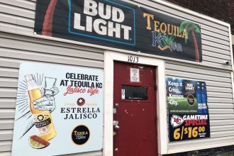 The exterior of Tequila KC, where nine people were shot, four of them fatally.  A sign on the bar door specifically says no guns are allowed. (Photo by Elle Moxley / KCUR)