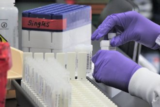 Samples undergo coronavirus testing at a lab that usually turns results within 24 hours. Nine months into the pandemic, dozens of Kansas nursing homes are still struggling with access to fast testing. (Photo by Celia Llopis-Jepsen, Kansas News Service)