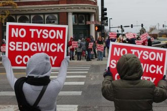 Protesters gather in downtown Wichita to demonstrate against a proposed Tyson facility in Sedgwick County. (Photo credit: Nadya Faulx, KMUW Radio)
