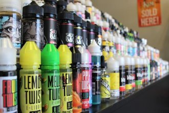 Some vape shops often have hundreds of e-liquid flavors. But some shops already limit sales to adults over age 21. (Photo by Celia Llopis-Jepsen / Kansas News Service)