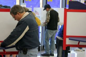 Voters casting ballots in Douglas County. (Photo by Stephen Koranda)