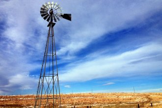 An old-fashioned windmill stands atop the wind-swept winter landscape of northwest Kansas, near St. Francis. (Photo by J. Schafer)