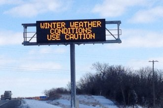 Weather sign along I-70 in eastern Kansas (File photo by J. Schafer)