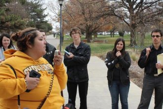 Graduate students at Wichita State University protest against the Republican tax reform efforts. (Photo Credit Stephan Bisaha, KMUW Radio)