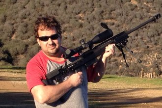 J. Schafer spends part of the 2014 holidays target shooting with an assortment of firearms, including this AR-30.