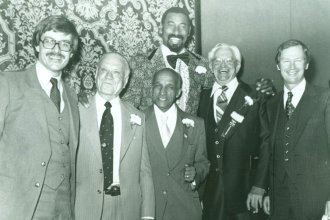 "Wilt Chamberlain with other Hall of Fame inductees, 1979. From left to right: Don Baker, A.C. ""Dutch"" Lonborg, John McLendon, Wilt Chamberlain, Bill Johnson, and Ted Owens. (Photo Courtesy of Spencer Research Library/KU)"